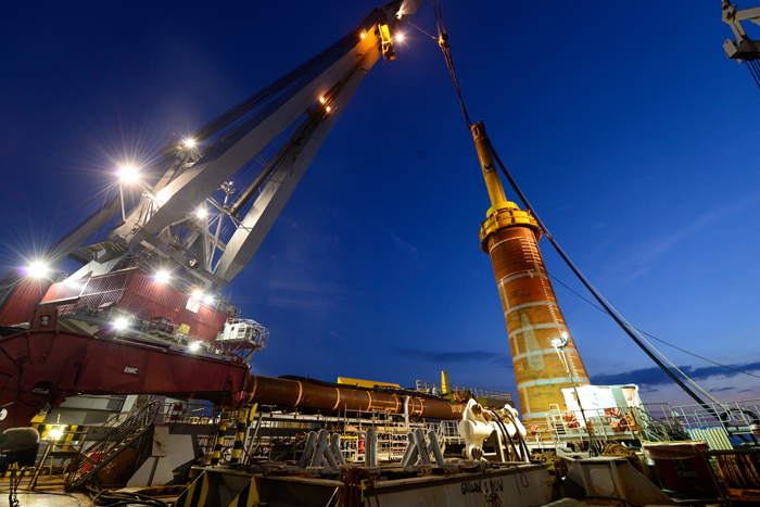 Night time turbine foundation installation works offshore.